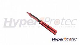 Un couteau papillon lame et manche rouge et noir
